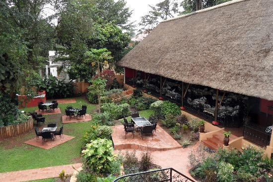 La Petite France Restaurant and Rooftop Terrace Bar : The garden and thatched roof dining room