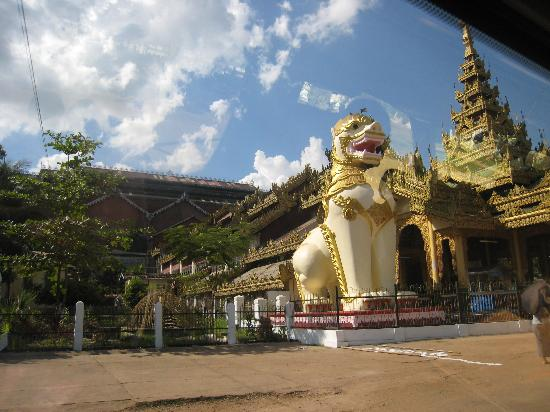 Shwethalyaung Buddha: One of the large lions 'guarding' the entrance to the temple