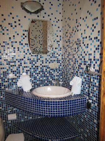 Bathroom With Cool Tile And Big Shelf Below Sink To Store Things