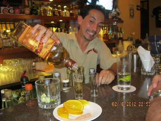Senor Puck's Bar & Grill: having a shot of Mezcal from our favourite bartender