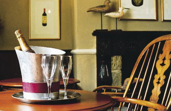 The White Swan Inn: Real Yorkshire Ales, fine wines served all day in the cozy bar