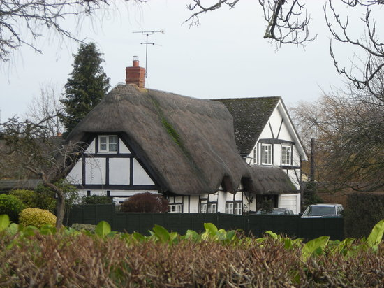 Dorsington, UK: A thatched cottage near Church Farm