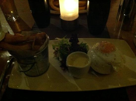 Brambles Seafood + Grill: Smoked salmon and haddock fishcake, duck egg, arran mustard cream sauce & chips was lovely :)