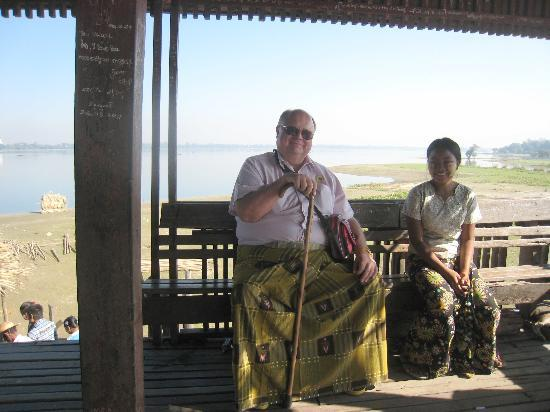 U Bein Bridge: Having a rest in the rest 'hut' with attached sales lady. Note the necklaces in her hand