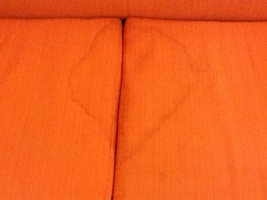 Motel 6 Del City: Sofa seat cushion stain - top side
