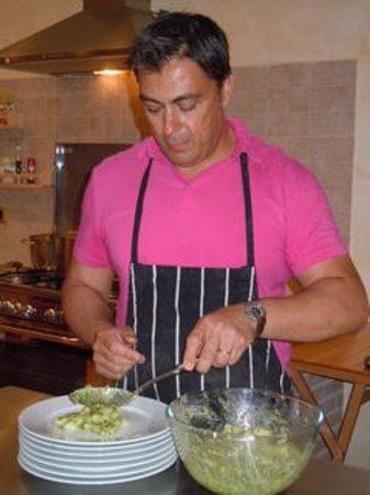 Convivio Rome Italian One Day Cooking Holidays : Head Chef, Guido serving up gnocci pesto