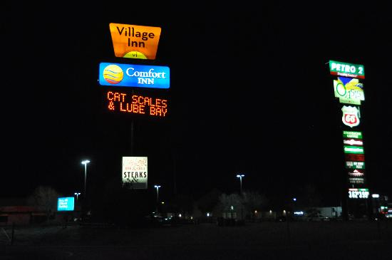 The Colby Comfort Inn sits between several businesses. The main entrance is directly across from