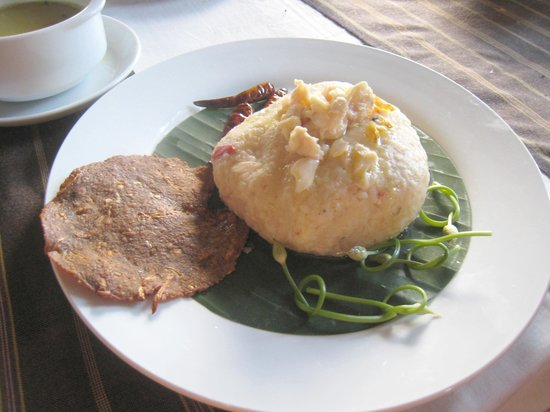 Green Tea Restaurant: Interesting looking Shan rice(?) cake with a fish 'cracker' - bit of an acquired taste!