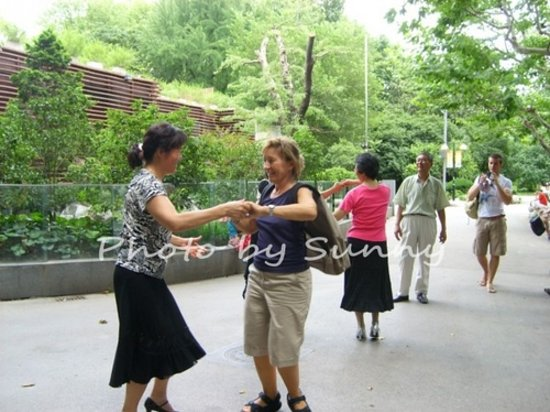 Sunny Tours Shanghai: My customer is dancing with the local
