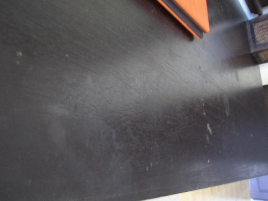 The Verandah: Dirty table with scuffs