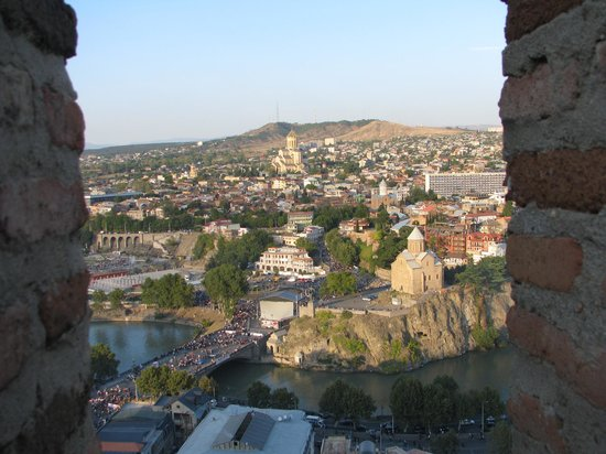 Narikala Fortress: view from the 'window' - Metekhi Church and Holy Trinity Cathedral of Tbilisi