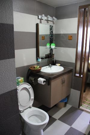 Sri Sayang Resort Service Apartment: SS25-03 Ensuite/Master Bathroom - toilet, vanity, shower with bench seat, doorway to master bedr