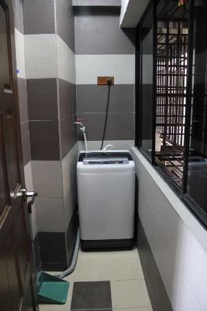 Sri Sayang Resort Service Apartment: SS25-03 Laundry - washing machine with hanging space (through the windows to the right and a fol
