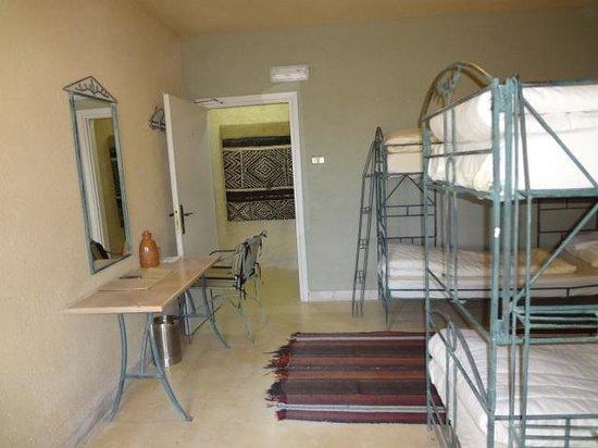 Dana Guesthouse: dresser, chair and carpet