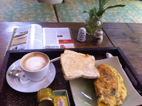 The Willow Boutique Hotel: Reading up on Phnom Penh over breakfast...Omelette & Latte