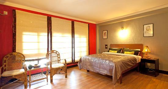 Ambassador Garden Home: Spacious Super Deluxe Room with comfortable bed and large private washroom