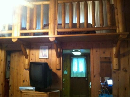 Blackhawk Lodges: view from the entry, thekitchen and door to back porch from living room with loft upstairs