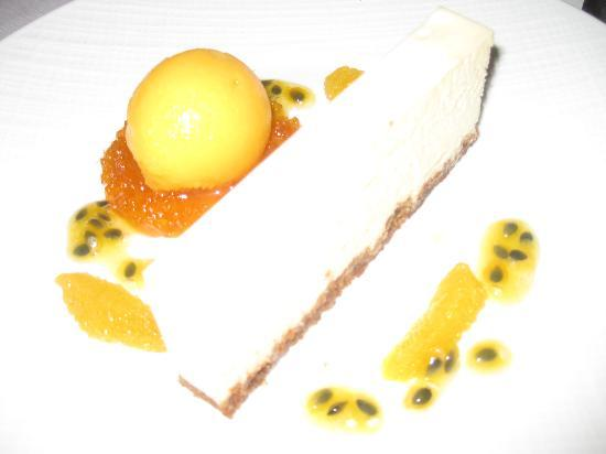 Brillat savarin cheesecake with passion fruit sauce and clementine sorbet