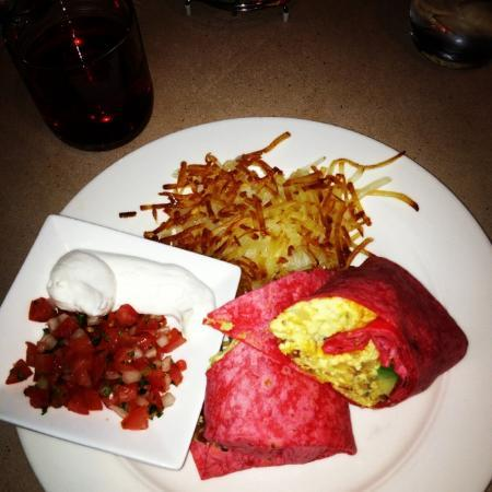 Hyatt Regency Westlake: Westlake Wrap - Scrambled eggs, onion, smoked bacon, avocado and cheddar cheese in a sun-dried t