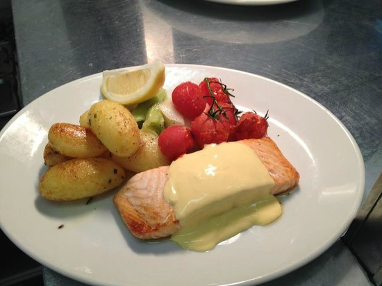 salmon in hollandaise sauce with garlic roasted new potatoes, buttered ...