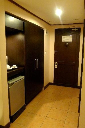 Hotel Tropika Davao: Fridge, Coffee & Tea Corner and Room Entrance =)