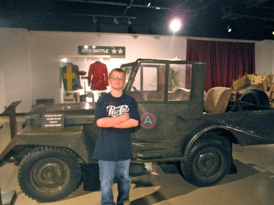 Patton Museum of Cavalry and Armor: my son in front of Gen. Patton's customized Jeep.