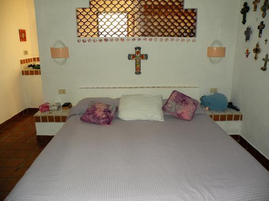 The Reef Condominiums: Master bedroom, bathroom area behind bed