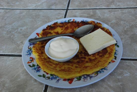 La Casita del Maiz: ready to eat Chorreada with sour cream and cheese