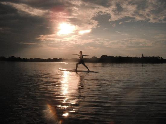 Paddleboard Orlando: Sunset paddleboard cruises are amazing!  Add a little yoga into the mix and what a picture!