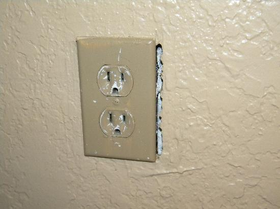 Turtle Beach Resort: Exposed electrical outlet in bedroom