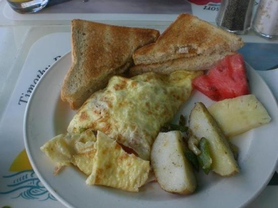 "Sunset Cafe: the Sunrise Cafe Special omelet - crab, veggies, cheese inside. toast, fruit and ""hash browns"" o"