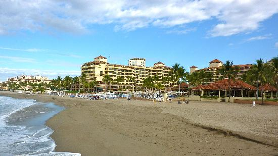 Marriott Puerto Vallarta Resort & Spa: A view of the hotel from the beach.  Dark sand, darker water.