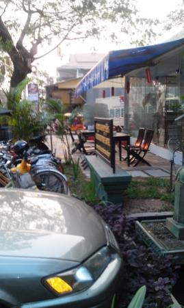 Central Hostel: Part of the outdoor eating area, new mini mart