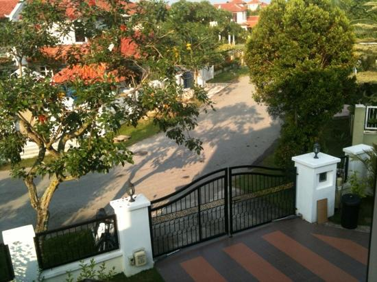 Rumah Putih Bed and Breakfast: looking out our room window at the front gate