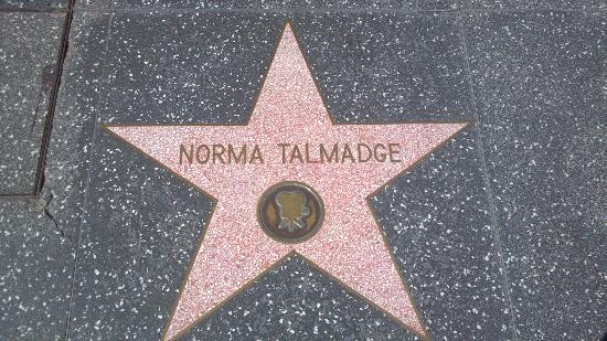 Glitterati Tours: The Walk of Fame star for Norma Talmadge.  Norma had the first set of celebrity hand prints at G