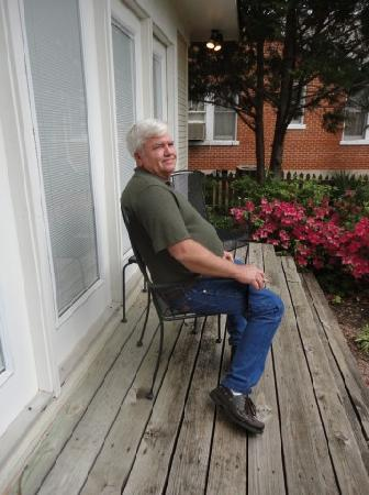 Judge Porter House Bed and Breakfast: my husband enjoying the back deck