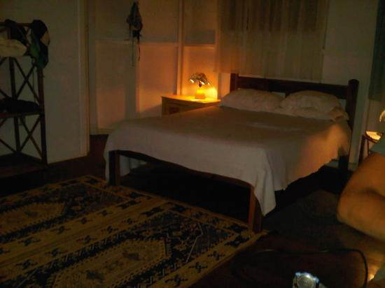 Aguas Claras Beach Cottages: This is the bed area. It's like a studio apartment.