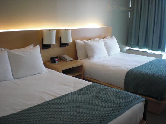 Habitacion 2 camas queen fotograf a de harbor hotel for Precio habitacion hotel