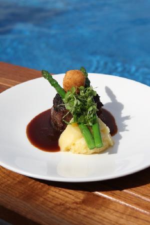Tides Restaurant & Bar : Our signature dish, Black Angus beef fillet w exotic mushroom crust, Paris mash, asparagus, frie
