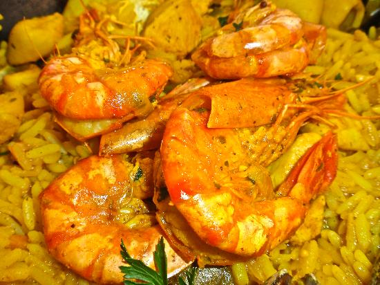 TUSCANY BEACH RESTAURANT: Fresh Prawn topped the Paella dish