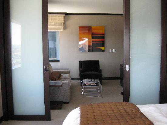 Sliding doors divide the bedroom from the living room Picture of