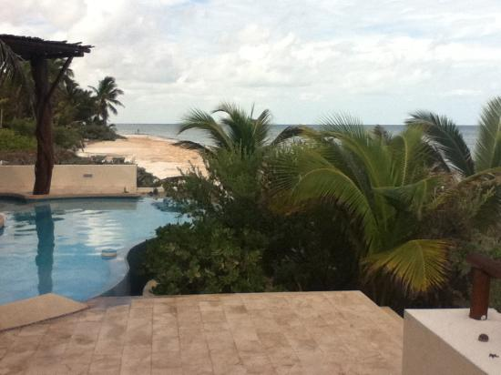 Chicxulub Puerto, Mexico: looking across the patio, over the pool, and along the beach