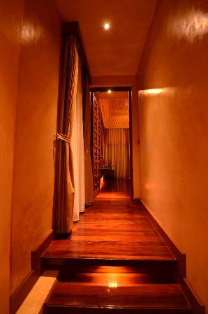 The Baray Villa: Hallway to room - everything luxuriously appointed with wood