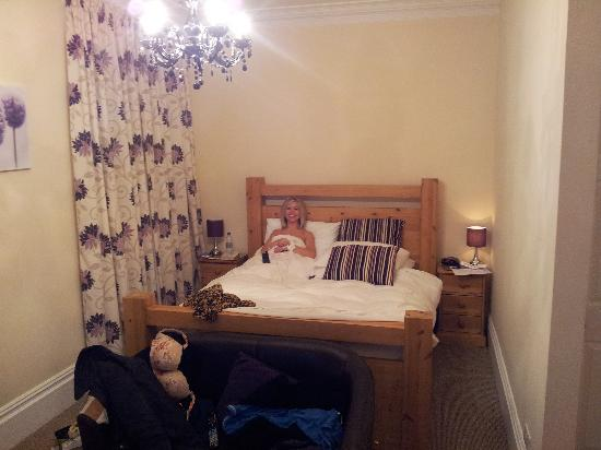 Tracey in our huge bed.