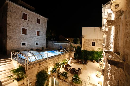 Dobrota, Montenegro: Hidden courtyard with a swimming pool, in the evening
