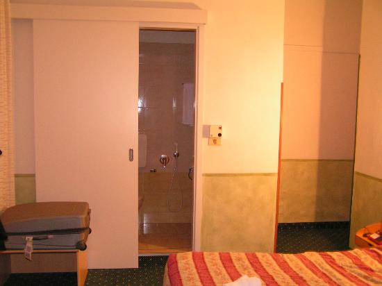 Astoria : Door to the batroom, small but modern fitted