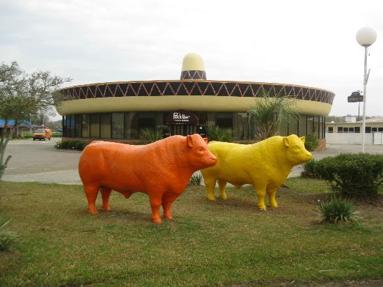 South of the Border: Peddlers Steakhouse with concrete cattle
