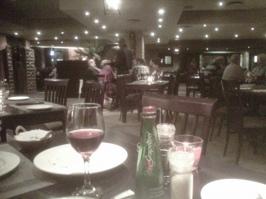 Bhandaris Indian Restaurant: Disagree with dark and not cosy. Blackberry has a weak cam but all the lighting is clear!
