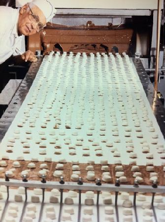 Philadelphia Candies: Creams being enrobed in our famous milk chocolate