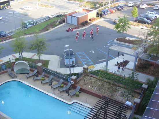 Aloft Tallahassee Downtown: Marist College Cheerleaders practicing in parking lot.